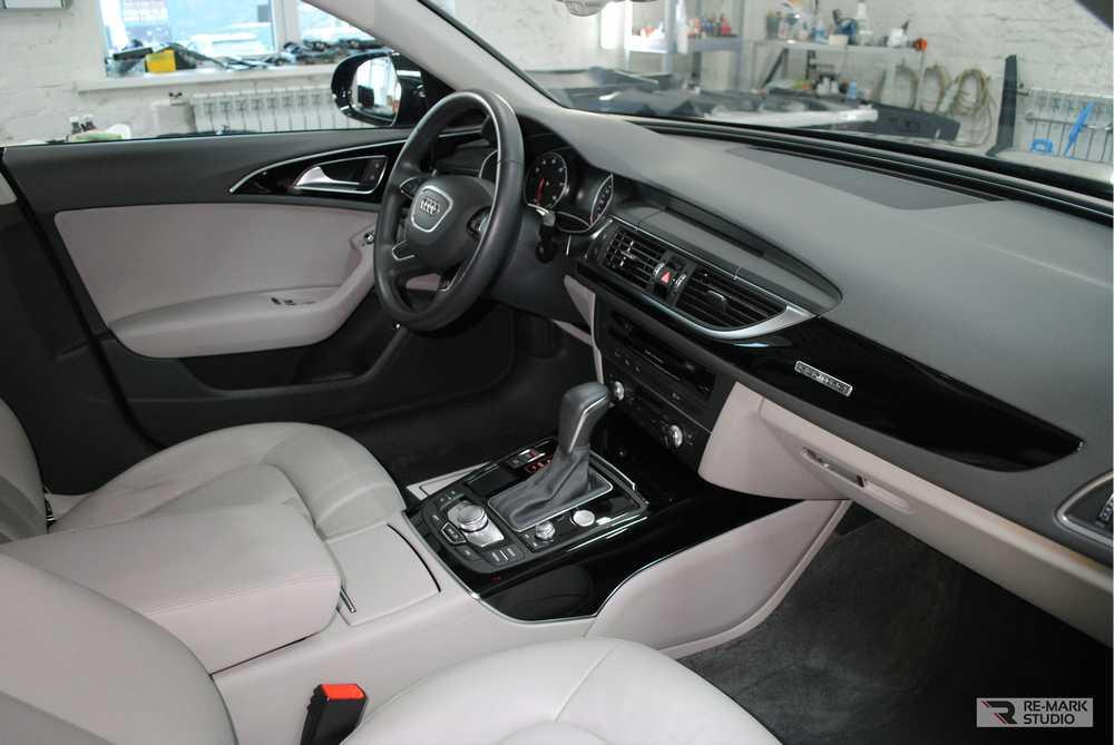 Смотреть на фото салона Audi A6 после еврохимчистки.