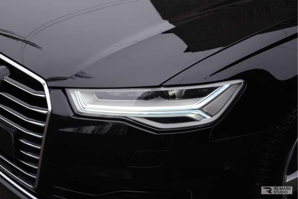 Смотреть на фото фары Audi A6 после бронировки антигравийной пленкой PremiumSheild.